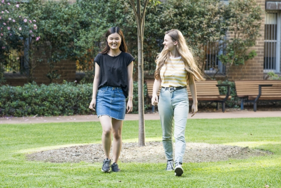 two female students walking on unsw campus