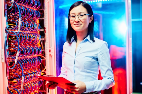 A female leader in a server room