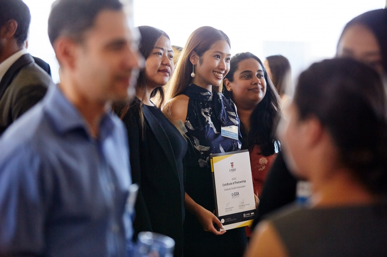 UNSW Business School student with her partner certificate