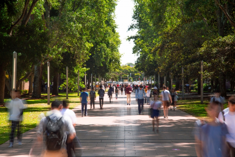 People walking down the UNSW walkway