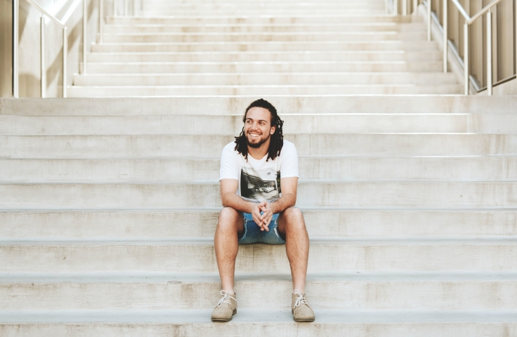 Co-op degree student sitting on unsw stairs