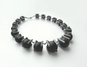 a necklace of 18 spherical coal pieces mounted in oxidised sterling silver settings