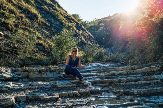 Woman sitting on a rock formation