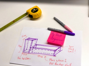 tape measure paper and pens