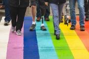 Protheses walking across rainbow ground